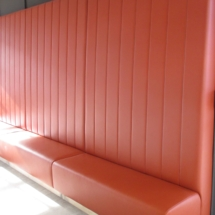 high back banquette with vertical channels