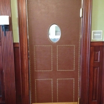 leather wrapped door with nails